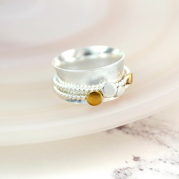 Sterling silver spinning ring with brass circle detail | Image 1