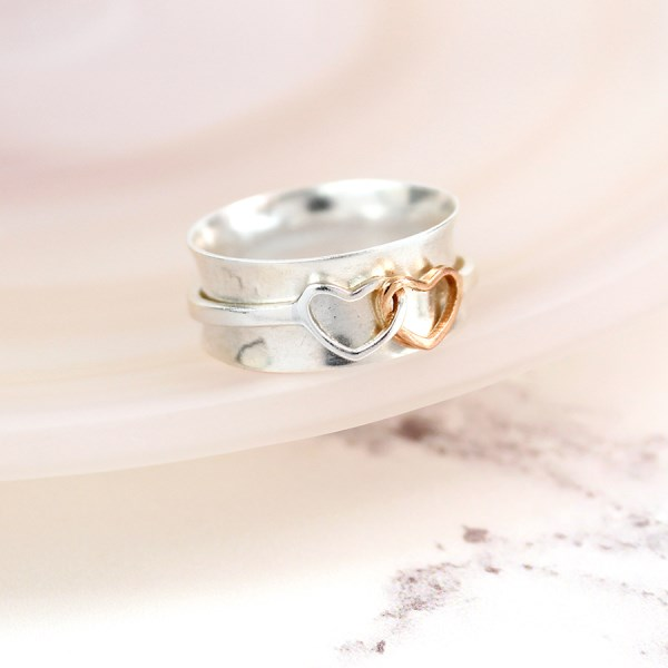 Sterling silver linked hearts spinning ring with rose gold | Image 1