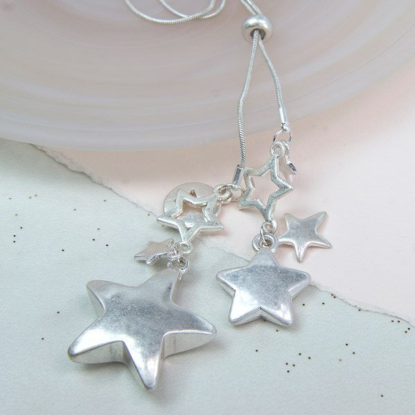 Silver plated star cluster necklace in a worn finish | Image 1