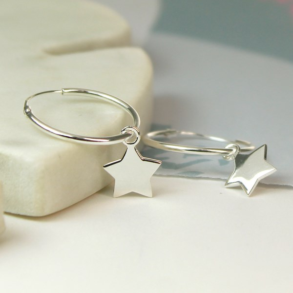 Sterling silver hoop earrings with star charms | Image 1