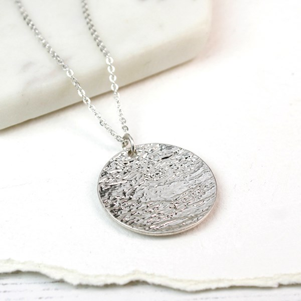 Silver plated long necklace with large textured disc | Image 1