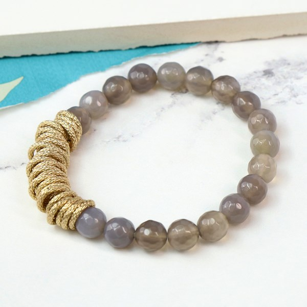 Smoky crystal bead bracelet with textured golden rings | Image 1