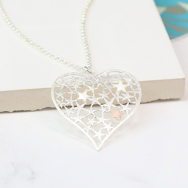 Silver plated scratched heart necklace filled with stars | Image 1