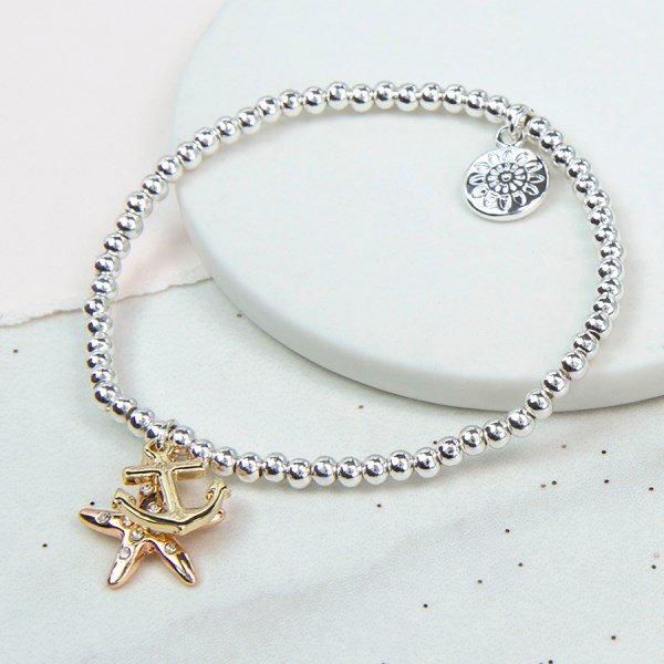 Silver plated bracelet with golden anchor and rose gold starfish | Image 1
