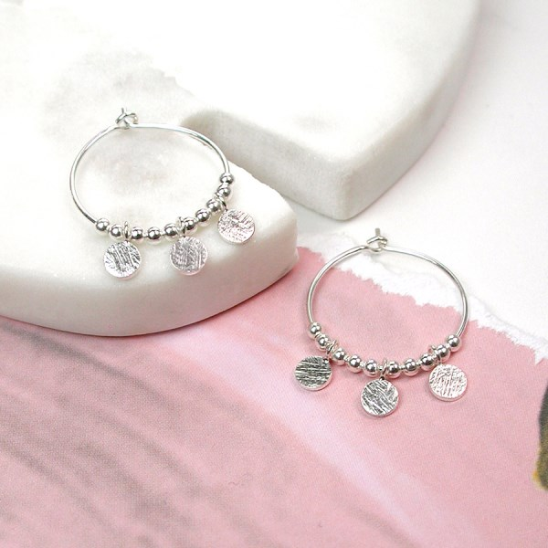 Sterling silver hoop earrings with scratched discs and beads | Image 1