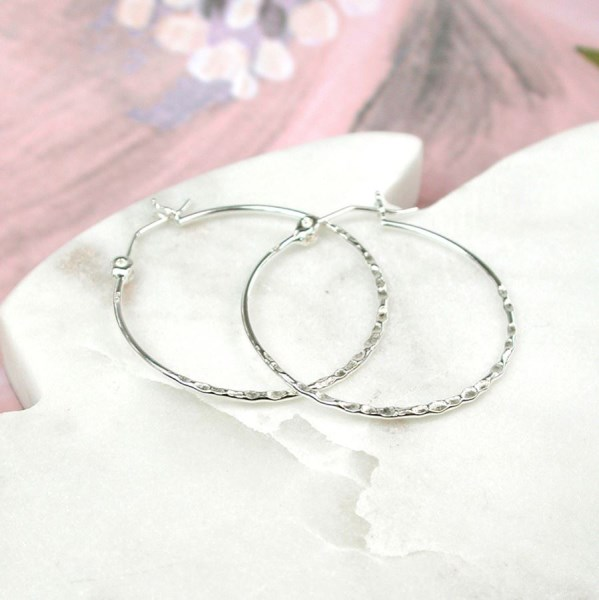 Sterling silver hoop earrings with a textured finish | Image 1