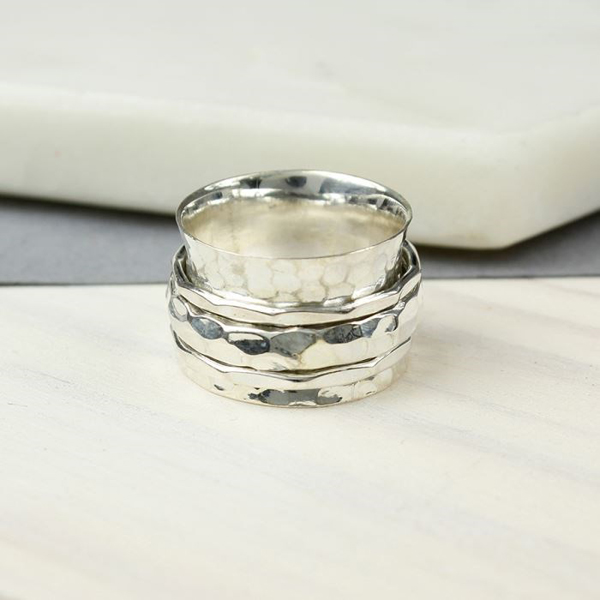 All silver spinning ring with three textured moving bands | Image 1