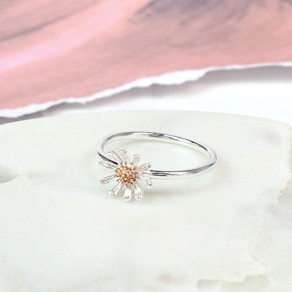 Sterling silver daisy ring with real rose gold detailing | Image 1