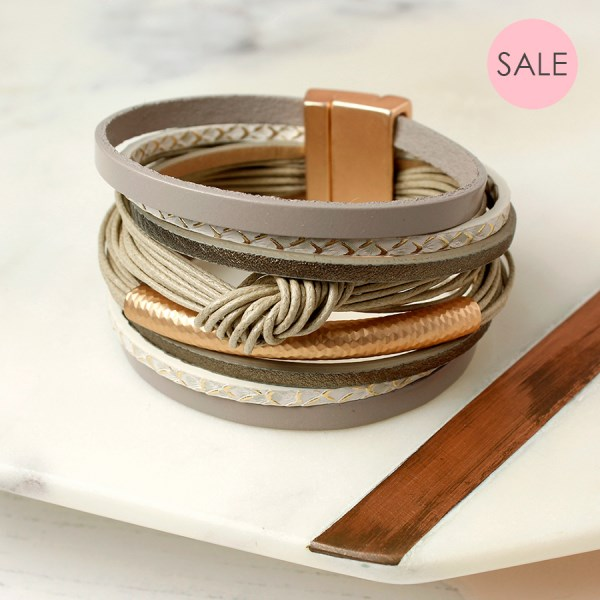 Taupe leather layered knot bracelet with golden detail | Image 1