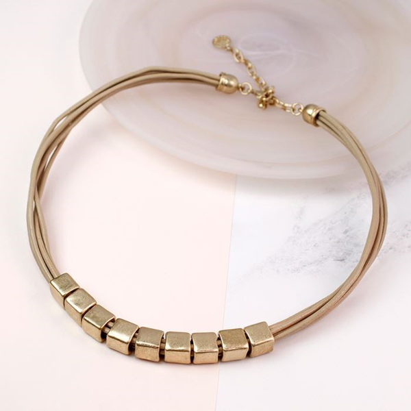 Taupe leather necklace with worn gold plated cube beads | Image 1