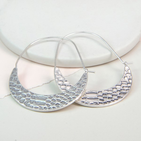 Silver plated crescent earrings with textured surface | Image 1
