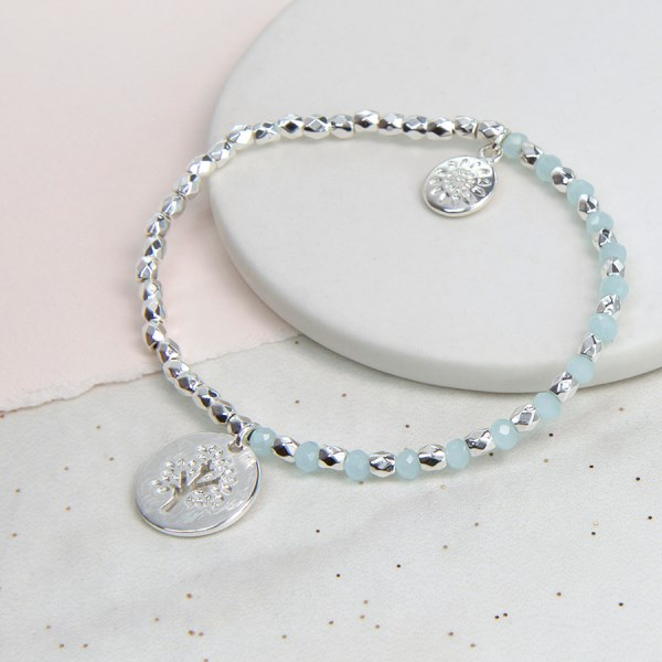Silver plated and aqua bead bracelet with tree disc charm | Image 1