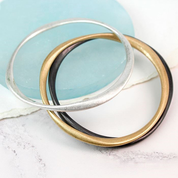 Triple bangle set in silver, gold and hematite finishes | Image 1