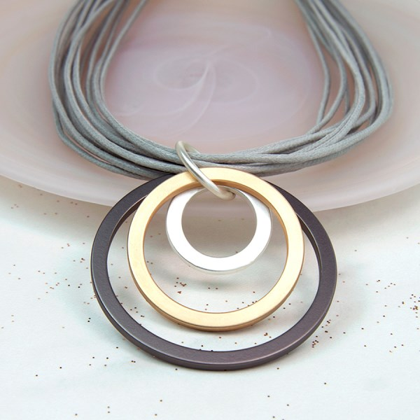 Mixed metallic hoop and multistrand grey cord necklace | Image 1