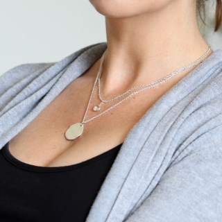 Silver plated wave disc and crystal layered necklace | Image 6
