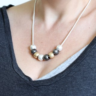 Silver, gold and hematite metallic worn bead necklace | Image 3