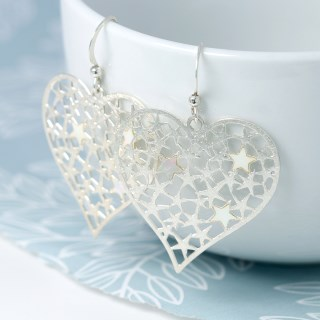 Silver plated scratched heart earrings filled with stars | Image 4