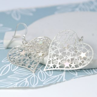 Silver plated scratched heart earrings filled with stars | Image 5