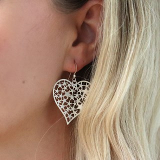 Silver plated scratched heart earrings filled with stars | Image 2