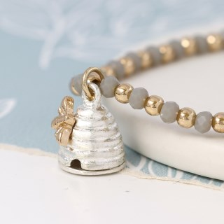 Grey bead bracelet with a silver and gold beehive charm | Image 3