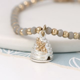 Grey bead bracelet with a silver and gold beehive charm | Image 2