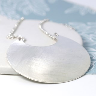 Silver plated scratched crescent pendant on a long chain | Image 4