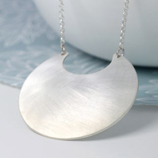 Silver plated scratched crescent pendant on a long chain | Image 2