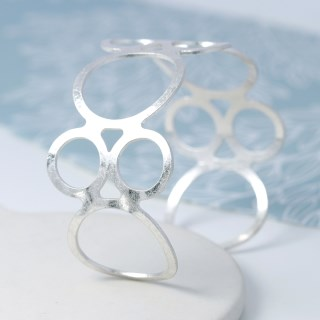 Silver plated open circles bangle with worn finish | Image 3