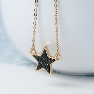 Golden plated star necklace with black sparkle centre | Image 4