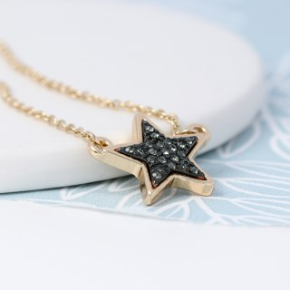 Golden plated star necklace with black sparkle centre | Image 3