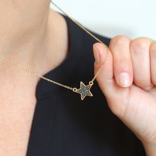 Golden plated star necklace with black sparkle centre | Image 7