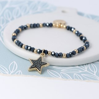Dark bead and golden star bracelet with sparkle centre | Image 4