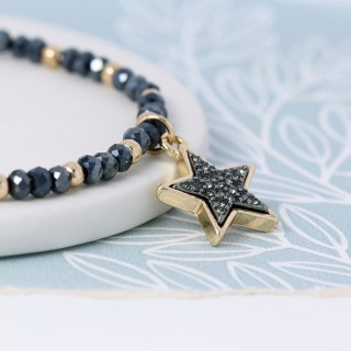 Dark bead and golden star bracelet with sparkle centre | Image 2