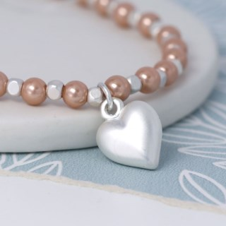 Pink faux pearl and silver plated matt heart bracelet | Image 2