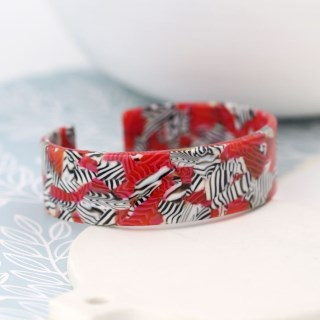 Red acrylic bangle with striking zebra pattern | Image 2