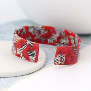 Red acrylic bangle with striking zebra pattern | Image 3