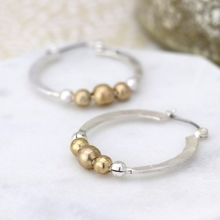 Silver plated textured hoop earrings with golden beads | Image 2