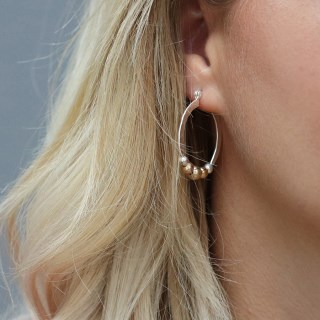 Silver plated textured hoop earrings with golden beads | Image 4