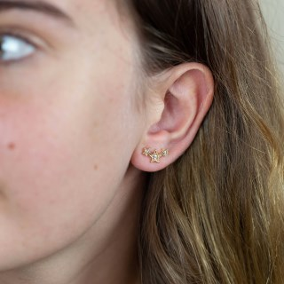 Gold plated triple star earrings with crystals and a worn finish | Image 4