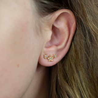 Gold plated triple star earrings with crystals and a worn finish | Image 3