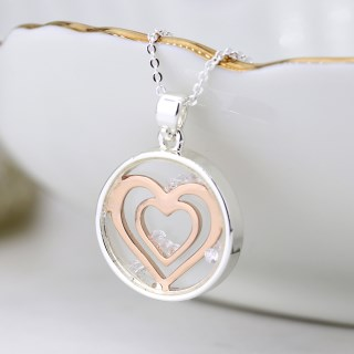 Circle necklace with enclosed rose gold hearts and crystals | Image 3