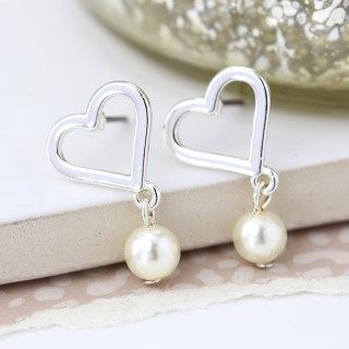 Silver plated heart and ivory pearl stud earrings | Image 4