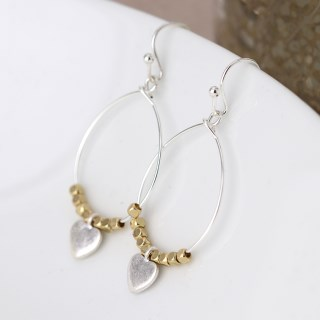 Worn silver teardrop earrings with golden beads and heart | Image 2