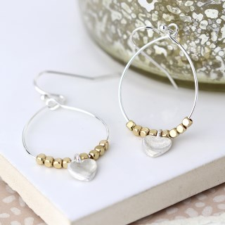 Worn silver teardrop earrings with golden beads and heart | Image 4
