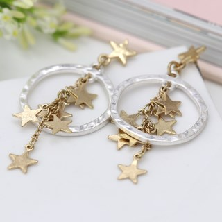 Worn gold multi star cluster and silver hoop earrings | Image 4