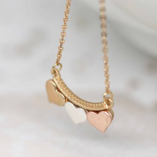 Silver, gold and rose gold triple hearts necklace | Image 3