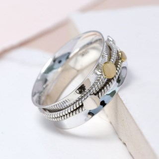 Sterling silver spinning ring with brass circle detail | Image 2