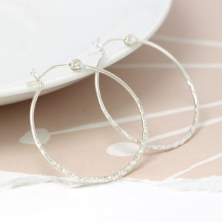 Sterling silver hoop earrings with a textured finish | Image 3