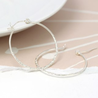 Sterling silver hoop earrings with a textured finish | Image 4