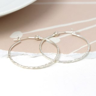Sterling silver hoop earrings with a textured finish | Image 5
